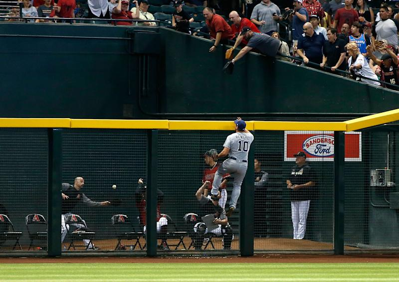 PHOENIX, AZ - APRIL 14: Hunter Renfroe #10 of the San Diego Padres leaps on the outfield fence as he watches a home run by David Peralta #6 of the Arizona Diamondbacks land in the bullpen during the sixth inning of an MLB game at Chase Field on April 14, 2019 in Phoenix, Arizona. (Photo by Ralph Freso/Getty Images)