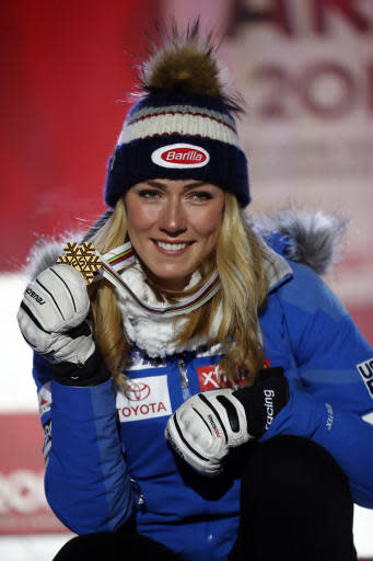 United States' Mikaela Shiffrin poses with her gold medal of the women's super-G, at the alpine ski World Championships in Are, Sweden, Tuesday, Feb. 5, 2019. (AP Photo/Gabriele Facciotti)