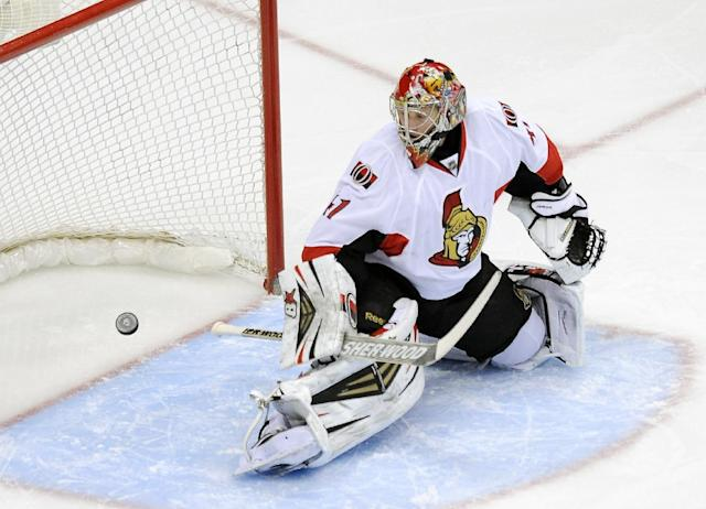 Ottawa Senators goalie Craig Anderson watches as the puck goes in the net on a goal by Colorado Avalanche left wing Jamie McGinn in the first period of an NHL hockey game on Wednesday, Jan. 8, 2014, in Denver. (AP Photo/Chris Schneider)