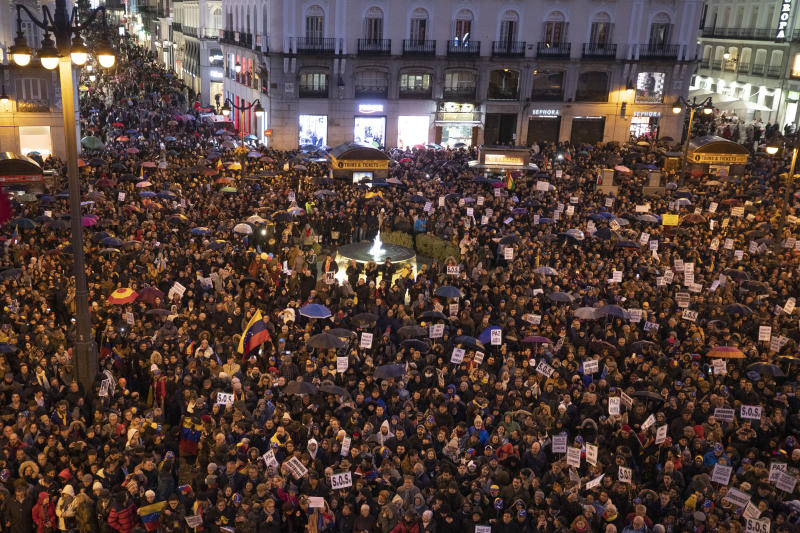 Venezuelans pack the Puerta del Sol square waiting for Juan Guaido during his visit to Madrid, Spain, Saturday, Jan. 25, 2020.  Juan Guaido, the man who one year ago launched a bid to oust Venezuelan President Nicolas Maduro, arrived Saturday in Spain, where a thriving community of Venezuelans and a storm among Spanish political parties awaited him. (AP Photo/Paul White)