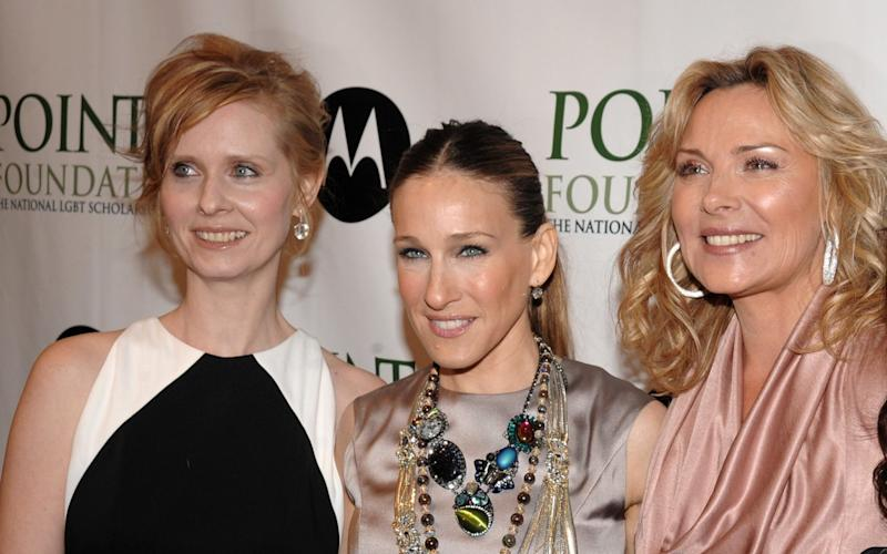 Nixon, left, with Cattrall right. Sarah Jessica Parker, middle, has been publicly spurned by her co-star - KRAPE