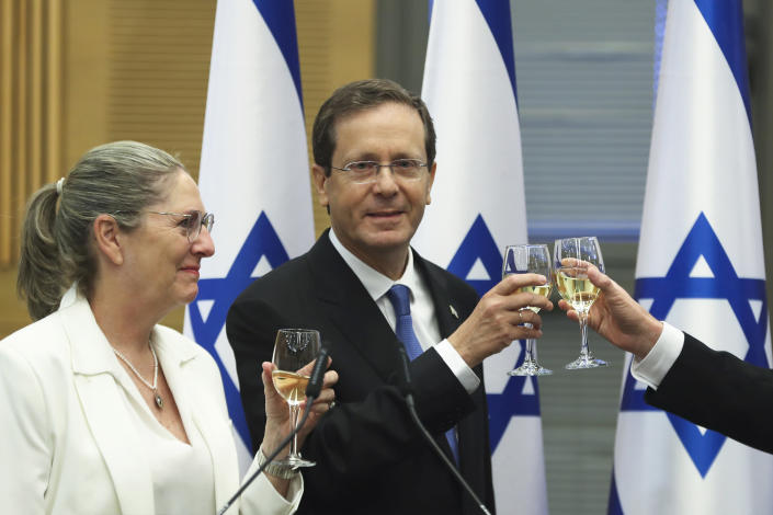 President-elect Isaac Herzog and his wife Michal celebrate after a special session of the Knesset whereby Israeli lawmakers elected the new president, at the Knesset, Israel's parliament, in Jerusalem Wednesday, June 2, 2021. (Ronen Zvulun/Pool Photo via AP)