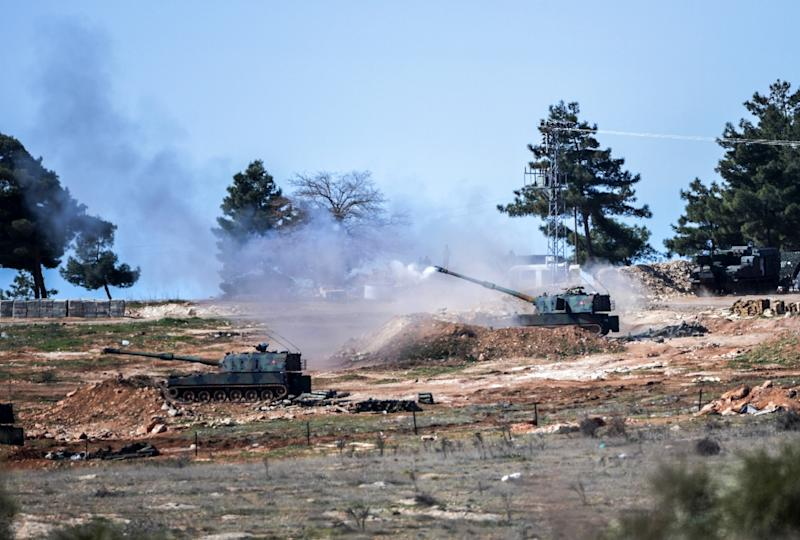 Turkish tanks fire towards the Syria border near the Oncupinar crossing gate close to the town of Kilis, in February 2016