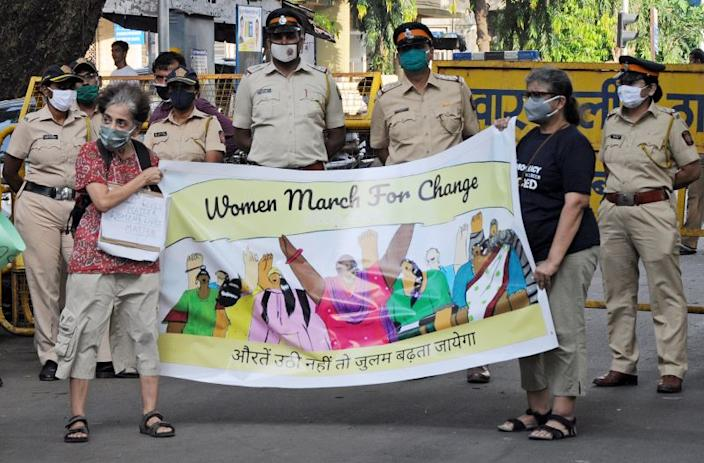 MUMBAI, INDIA - 2020/10/06: Protesters wearing face masks holding a banner saying 'women march for change' during the demonstration. Protesters gathered during a protest against caste based sexual violence happening in different parts of the country. (Photo by Ashish Vaishnav/SOPA Images/LightRocket via Getty Images)