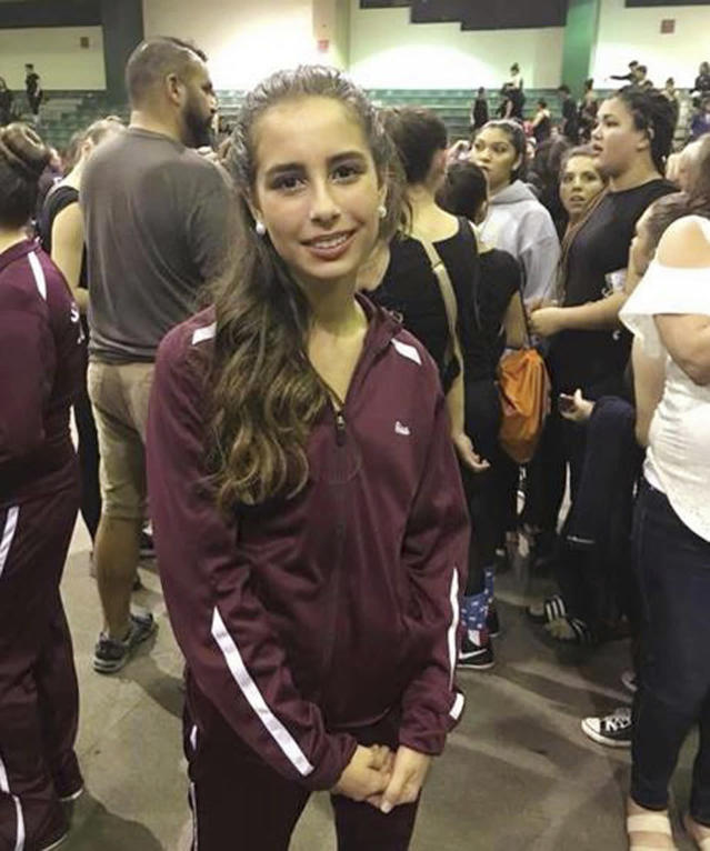 "<p>Student Gina Montalto is seen in an undated photo posted on the Facebook page of her aunt, Shawn Malone Reeder Sherlock. (Photo: Facebook via AP)<br>Gina Montalto was a freshman who participated on the winter color guard squad at the school. Friends and relatives posted tributes on Facebook, including mother Jennifer Montalto. ""She was a smart, loving, caring, and strong girl who brightened any room she entered. She will be missed by our family for all eternity,""€ said the post. (AP) </p>"