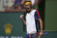 Taylor Fritz celebrates after winning a game against Matteo Berrettini, of Italy, at the BNP Paribas Open tennis tournament Tuesday, Oct. 12, 2021, in Indian Wells, Calif. (AP Photo/Mark J. Terrill)