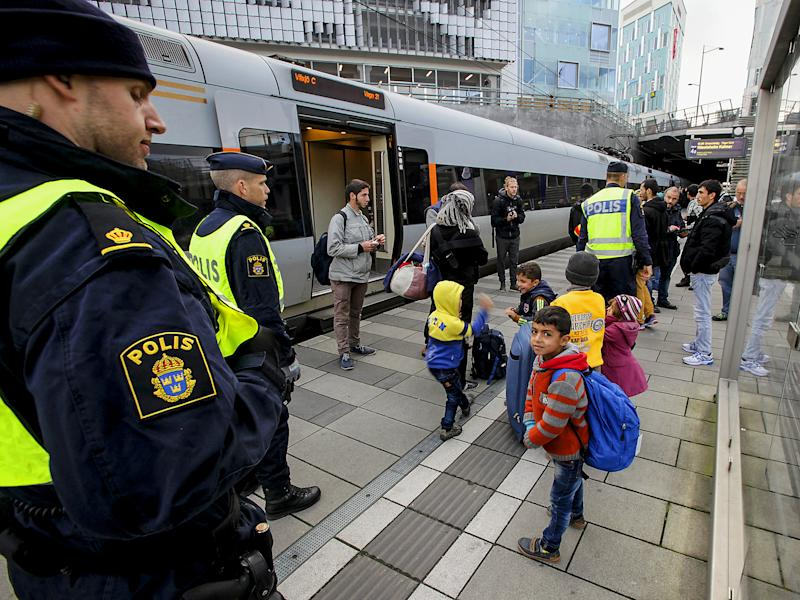 Police stand with refugee children in Sweden. The country has for years experienced the unique phenomenon of 'resignation syndrome': Getty