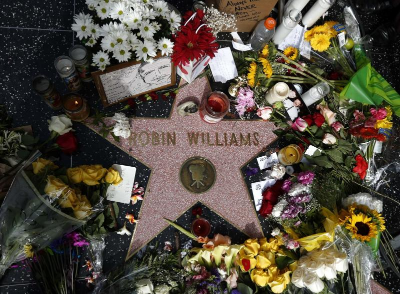 Flowers are seen on the late Robin Williams' star on the Hollywood Walk of Fame in Los Angeles