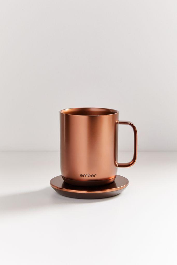 """<p><strong>Ember</strong></p><p>urbanoutfitters.com</p><p><strong>$129.95</strong></p><p><a href=""""https://go.redirectingat.com?id=74968X1596630&url=https%3A%2F%2Fwww.urbanoutfitters.com%2Fshop%2Fember-2-ceramic-10-oz-copper-mug&sref=https%3A%2F%2Fwww.cosmopolitan.com%2Fstyle-beauty%2Ffashion%2Fg27349308%2Fnew-dad-gift-ideas%2F"""" rel=""""nofollow noopener"""" target=""""_blank"""" data-ylk=""""slk:Shop Now"""" class=""""link rapid-noclick-resp"""">Shop Now</a></p><p>For a new dad, finding the time to enjoy your coffee before it's cold might be a challenge. This mug will keep any cup at the perfect temperature until he's ready to drink it. </p>"""