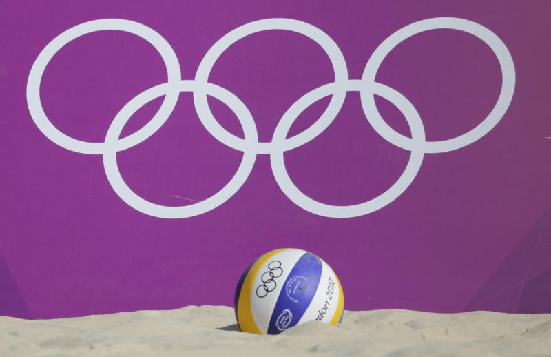 A volleyball lies in the sand in front of the Olympic rings during a beach volleyball match at the 2012 Summer Olympics, Thursday, Aug. 2, 2012, in London. (AP Photo/Dave Martin)