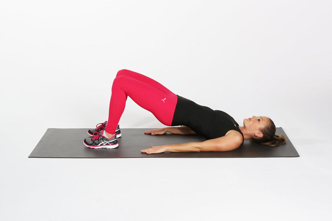 <ul> <li>On your mat, lie on your back with your knees bent and feet flat on the floor. Be sure to keep your feet underneath your knees, not in front. Plant your palms by each side, face down.</li> <li>Raise your hips up to the ceiling, tensing your abs and squeezing your butt as you do. You should be making a long diagonal line with your body, from shoulders to knees.</li> <li>Hold for a few seconds, making sure your spine doesn't round and your hips don't sag. Keep your abs and butt muscles engaged.</li> <li>Lower down to the ground; this is considered one rep.</li> </ul>