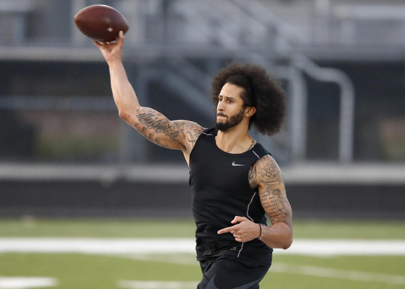 Free agent quarterback Colin Kaepernick throws