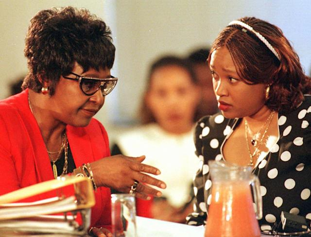 <p>Winnie Madikizela-Mandela, left, and her daughter Zinzi talk during a Truth and Reconciliation Commission hearing in Johannesburg, South Africa, on Dec. 2, 1997. The commission is investigating human rights abuses alledgedly committed by Madikizela-Mandela during the apartheid era. (Photo: Juda Ngwenya,Pool/AP) </p>
