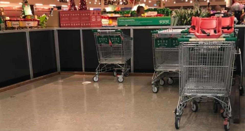 Trolley bay at Urangan Woolworths with a handful of trolleys available.