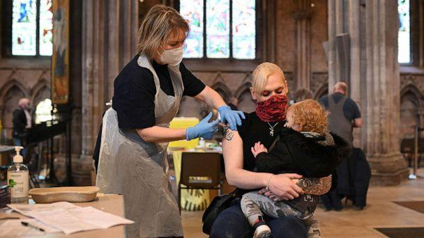 PHOTO: Members of the public receive a dose of the AstraZeneca/Oxford Covid-19 vaccine at Lichfield cathedral, which has been converted into a temporary vaccination centre, in Lichfield, England, on March 18, 2021. (Oli Scarff/AFP via Getty Images)