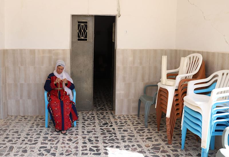 Muftiya Tlaib, Rep. Rashida Tlaib's grandmother, sits on the front porch of her home in Beit Ur Al-Fauqa, a village in the West Bank, on Sept. 10, 2019.