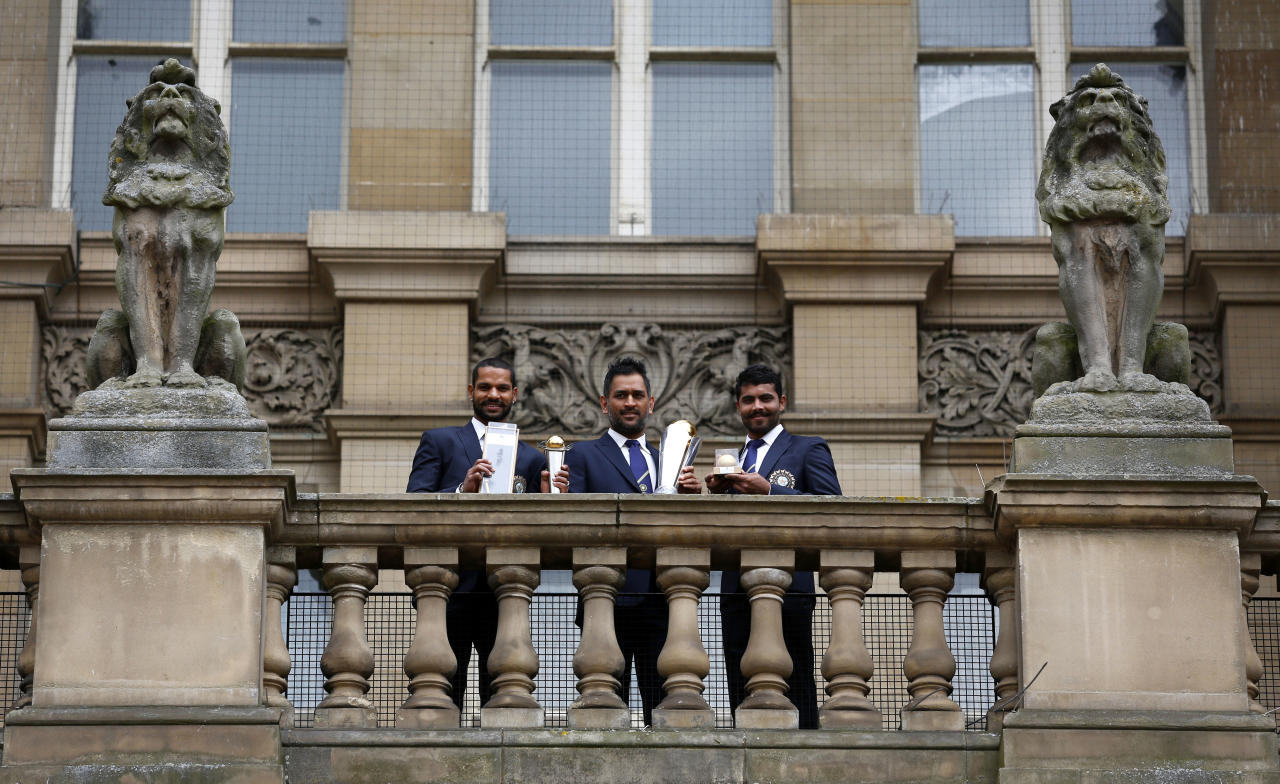 BIRMINGHAM, ENGLAND - JUNE 24: (L-R) Shikhar Dhawan, MS Dhoni and Ravindra Jadeja of India during ICC Champions Trophy Winners Photocall at the Birmingham City Council Building on June 24, 2013 in Birmingham, England. (Photo by Paul Thomas/Getty Images)