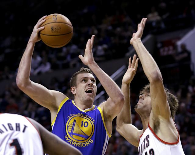 Golden State Warriors forward David Lee, left, drives to the hoop against Portland Trail Blazers center Robin Lopez during the first half of an NBA basketball game in Portland, Ore., Sunday, March 16, 2014. (AP Photo/Don Ryan)