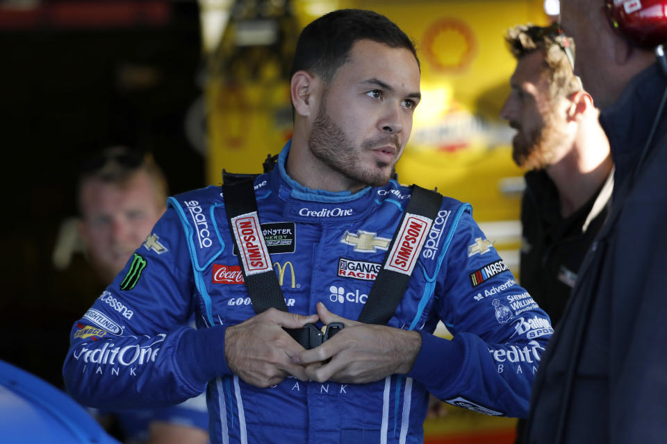 Kyle Larson suits up for practice for the NASCAR Cup Series auto race at Kansas Speedway in Kansas City, Kan., Friday, Oct. 18, 2019. (AP Photo/Colin E. Braley)