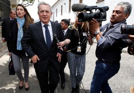 Colombian former President and Senator Uribe arrives before a meeting with Colombia's President  Santos at Narino Palace in Bogota, Colombia