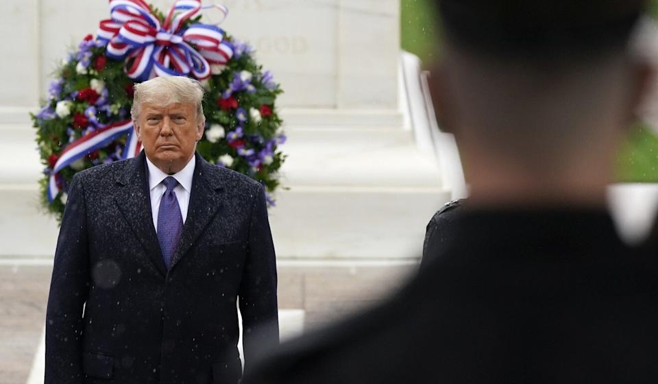 President Trump participating in a Veterans Day ceremony at the Tomb of the Unknown Soldier at Arlington National Cemetery on Wednesday. Trump trails Biden by more than 5 million votes nationally. Photo: AP