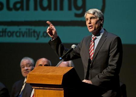 U.S. Senator Udall speaks during a memorial service marking the anniversary of the Tuscon shooting, at the University of Arizona campus
