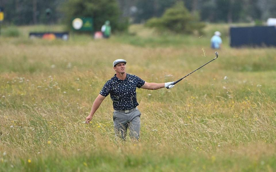 US golfer Bryson DeChambeau gestures from the deep rough on the 15th hole during his first round on day one of The 149th British Open Golf Championship at Royal St George's, Sandwich in south-east England on July 15, 2021. - GETTY IMAGES
