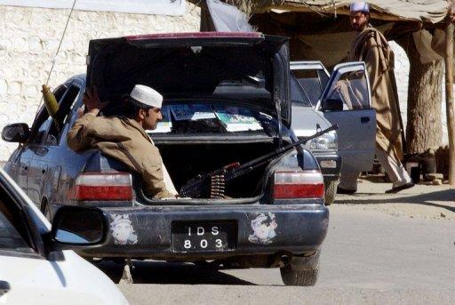 A tribesman is seen with his automatic weapon in the trunk of a car in Landi Kotal, in 2008