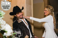 "<p>After the ceremony, the couple hosted a ""casual reception"" with catered food from <a href=""https://cowgirlkitchen.com/"" rel=""nofollow noopener"" target=""_blank"" data-ylk=""slk:Cowgirl Kitchen"" class=""link rapid-noclick-resp"">Cowgirl Kitchen</a>, plus <a href=""http://www.dukespirits.com/product/"" rel=""nofollow noopener"" target=""_blank"" data-ylk=""slk:Duke"" class=""link rapid-noclick-resp"">Duke</a> bourbon and <a href=""https://www.caymus.com/"" rel=""nofollow noopener"" target=""_blank"" data-ylk=""slk:Caymus"" class=""link rapid-noclick-resp"">Caymus</a> wine. This was followed by the traditional cake smash, featuring gluten-free cheesecakes by Patricia Mitchell.</p>"