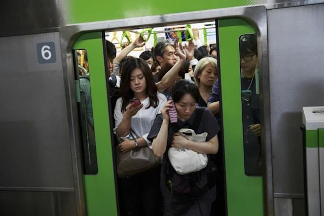 Employees are being encouraged to work from home during the Tokyo Olympics and Paralympics. (AFP Photo/Behrouz MEHRI)