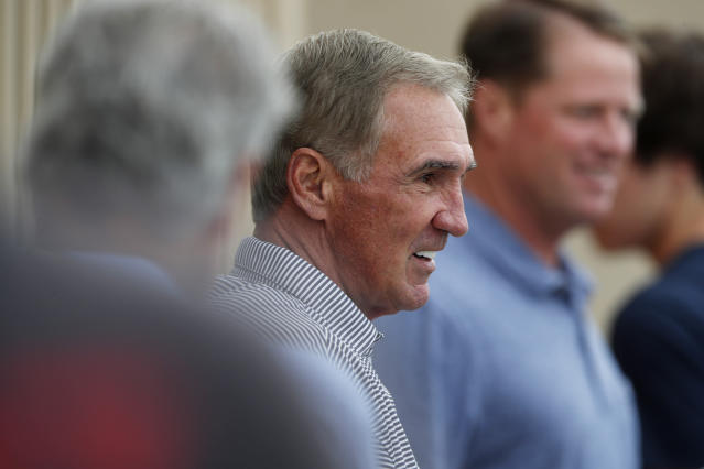 Former Denver Broncos head coach Mike Shanahan, center, looks on as his son, San Francisco 49ers head coach Kyle Shanahan (not shown), directs his team during a combined NFL football training camp with the San Francisco 49ers at the Broncos' headquarters Friday, Aug. 16, 2019, in Englewood, Colo. (AP Photo/David Zalubowski)