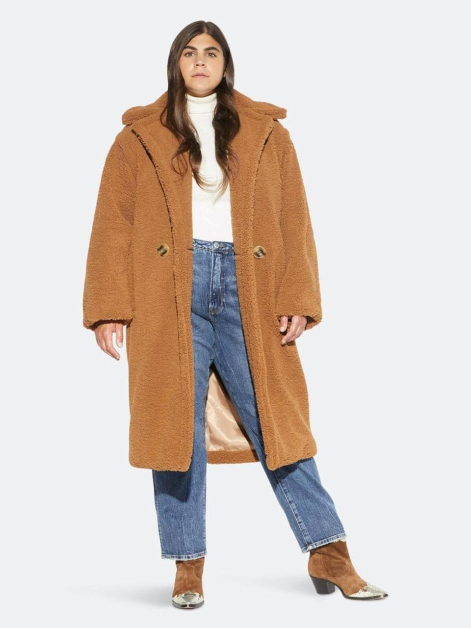 """Just looking at this fluffy sherpa coat makes us want to burrito ourselves in every square inch. $395, Verishop. <a href=""""https://www.verishop.com/apparis/marketplace/daryna-faux-shearling-long-coat-1/p6608796188866"""" rel=""""nofollow noopener"""" target=""""_blank"""" data-ylk=""""slk:Get it now!"""" class=""""link rapid-noclick-resp"""">Get it now!</a>"""