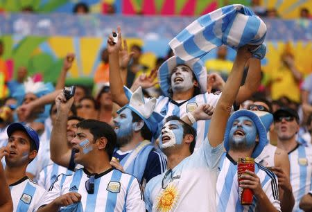 Argentina fans cheer during the 2014 World Cup quarter-finals between Argentina and Belgium at the Brasilia national stadium in Brasilia July 5, 2014. REUTERS/Dominic Ebenbichler