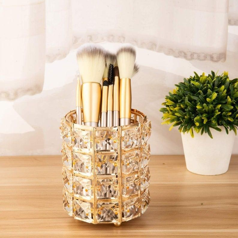 <p>The glamorous makeup lovers will appreciate this <span>Crystal Makeup Brush Holder</span> ($28). It comes in silver as well.</p>