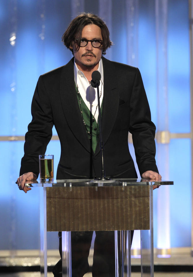 BEVERLY HILLS, CA - JANUARY 15: In this handout photo provided by NBC, actor Johnny Depp introduces Best Movie nomination onstage during the 69th Annual Golden Globe Awards at the Beverly Hilton International Ballroom on January 15, 2012 in Beverly Hills, California. (Photo by Paul Drinkwater/NBC via Getty Images)