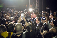 Romanian President Klaus Iohannis is surrounded by media after exit polls results indicate him as the leader of the presidential race, with up to 40 percent of the votes in Bucharest, Romania, Sunday, Nov. 10, 2019. An election runoff will take place on Nov. 24. (AP Photo/Andreea Alexandru)