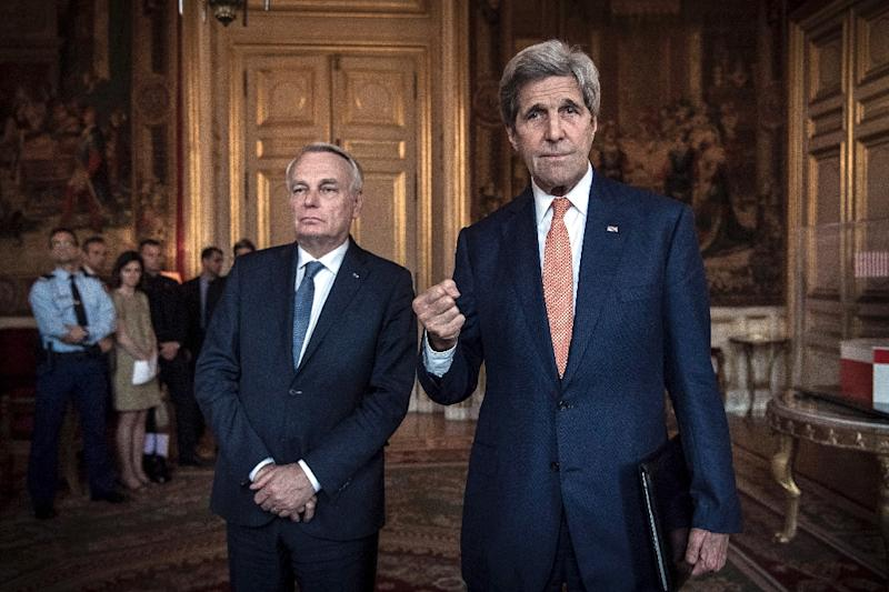 US Secretary of State John Kerry (R) talks to the press as French Foreign Minister Jean-Marc Ayrault listens prior a meeting about Syria at the French Foreign ministry in Paris on May 9, 2016