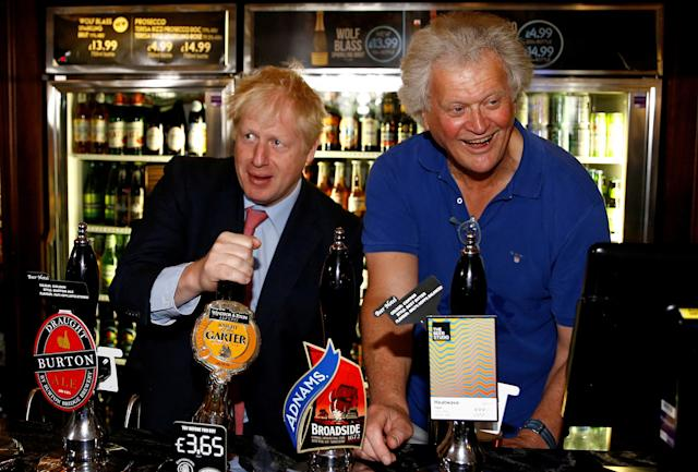 Prime minister Boris Johnson (L) and JD Wetherspoon boss Time Martin (R). Johnson announced pubs could reopen next month. Photo: Henry Nicholls/AFP via Getty Images