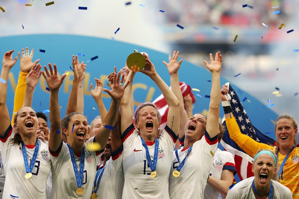 LYON, FRANCE - JULY 07:  Megan Rapinoe of the USA lifts the FIFA Women's World Cup Trophy following her team's victory in the 2019 FIFA Women's World Cup France Final match between The United States of America and The Netherlands at Stade de Lyon on July 07, 2019 in Lyon, France. (Photo by Joosep Martinson - FIFA/FIFA via Getty Images)