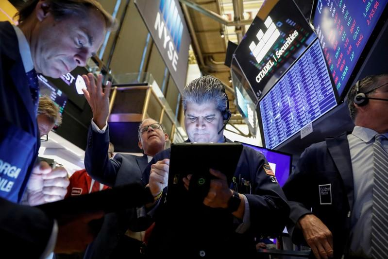 Solid data, trade hopes lift Wall Street to records