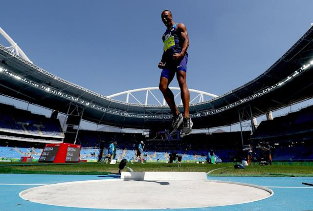 <p>Ashton Eaton of the United States reacts during the Men's Decathlon Shot Put on Day 12 of the Rio 2016 Olympic Games at the Olympic Stadium on August 17, 2016 in Rio de Janeiro, Brazil. (Photo by Alexander Hassenstein/Getty Images) </p>