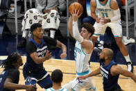 Charlotte Hornets' LaMelo Ball (2) looks to pass the ball as Minnesota Timberwolves' Jarrett Culver and Jordan McLaughlin, right, defend during the first half of an NBA basketball game Wednesday, March 3, 2021, in Minneapolis. (AP Photo/Jim Mone)