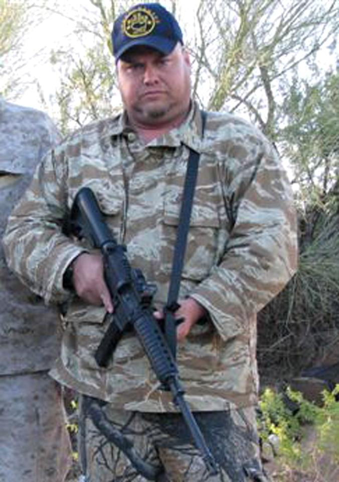 "FILE - This undated file photo provided in 2010 by Jason ""JT"" Ready, shows Ready posing with an assault rifle. Police have identified Ready on Thursday, May 3, 2012, as one of the five people killed in a shooting in a Phoenix suburb on Wednesday. (AP Photo/Courtesy Jason ""JT"" Ready, File)"