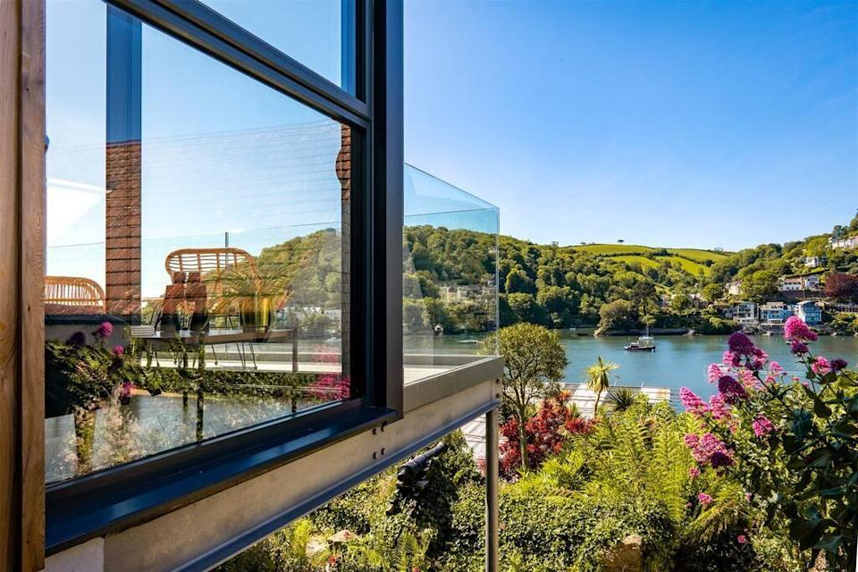 """<p>This super-stylish townhouse boasts incredible views and will take your breath away. With its floor-to-ceiling windows and California-style sun deck, the beach house rental in Devon is a dream. Set on the beachfront in Kingswear, you can take in the views of the River Dart from the luxury four-bedroom pad. We like the open plan living and high-spec furniture.</p><p><strong>Sleeps:</strong> 10 (8 adults + 2 children maximum)</p><p><a class=""""link rapid-noclick-resp"""" href=""""https://go.redirectingat.com?id=127X1599956&url=https%3A%2F%2Fwww.booking.com%2Fhotel%2Fgb%2Ftwo-guns-contemporary-stylish-townhouse-with-stunning-sea-views.en-gb.html%3Faid%3D2070929%26label%3Dbeach-house-rentals&sref=https%3A%2F%2Fwww.redonline.co.uk%2Ftravel%2Finspiration%2Fg36164603%2Fbeach-house-rentals%2F"""" rel=""""nofollow noopener"""" target=""""_blank"""" data-ylk=""""slk:CHECK AVAILABILITY"""">CHECK AVAILABILITY</a></p>"""