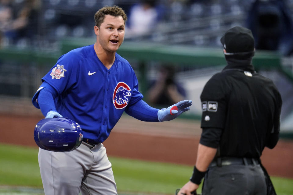 Chicago Cubs' Joc Pederson, left, disagrees with a third-strike call by umpire Will Little during the first inning of the team's baseball game against the Pittsburgh Pirates in Pittsburgh, Saturday, April 10, 2021. (AP Photo/Gene J. Puskar)