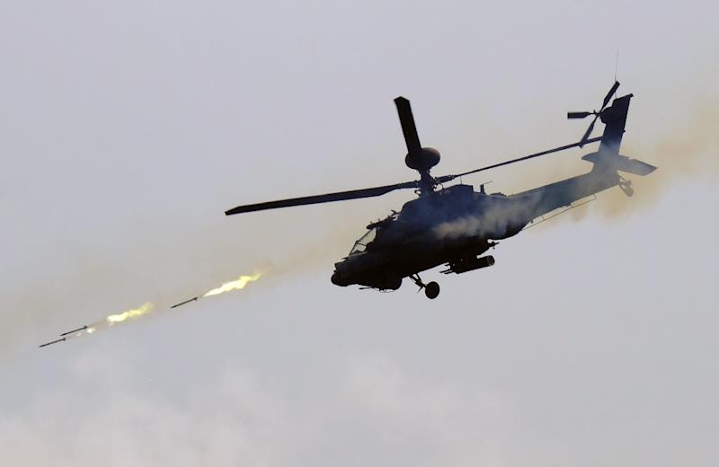 A US-made AH-64E Apache helicopter launches rockets during a live-fire drill in southern Pingtung in August 2016