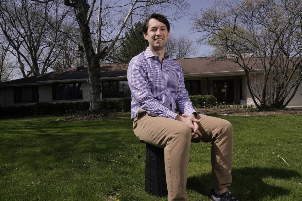 Patrick Proctor Brown poses for a picture outside his Elm Grove, Wis., home on April 23, 2021. At the 100-day mile marker, polls show most Americans are giving Biden positive marks for his early performance, particularly for his management of coronavirus pandemic. But in one pocket of swing-state Wisconsin, where a suburban surge helped put Biden in the White House, interviews with voters show that support often falls short of adulation (AP Photo/Morry Gash)