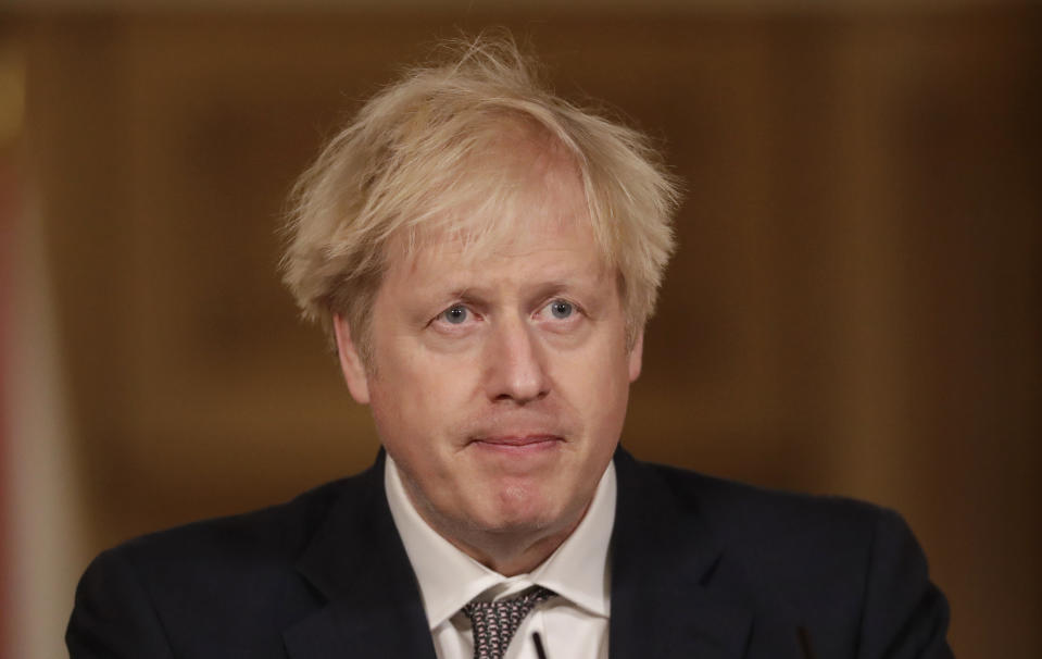 LONDON, ENGLAND - DECEMBER 16: United Kingdom Prime Minister Boris Johnson speaks during a news conference on the ongoing situation with the coronavirus pandemic, inside 10 Downing Street on December 16, 2020 in London, England. (Photo by Matt Dunham - WPA Pool/Getty Images)