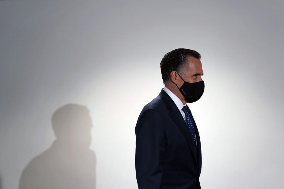 FILE - In this Jan. 26, 2021, file photo, Sen. Mitt Romney, R-Utah, arrives for a Republican policy luncheon on Capitol Hill in Washington. Romney is being honored with the JFK Profile in Courage Award during a virtual event Wednesday, May 26, 2021, for being the only Republican to vote to convict former President Donald Trump during his first impeachment trial. (AP Photo/Susan Walsh, File)