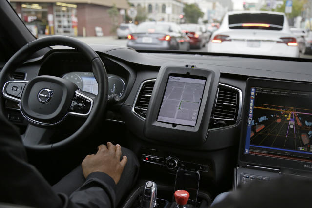 In this Dec. 13, 2016 photo, an Uber driverless car waits in traffic during a test drive in San Francisco. (AP Photo/Eric Risberg, File)